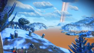 An icy alien landcape featuring low, snowcapped hills and a pumpkin orange river. The skies are blue and the trees are pointy and coniferous. In the foreground, a handful of standing cylindrical rocks stick vertically out of the ground.