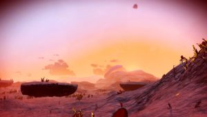 This alien landscape feels pink. The skies are pink and orange and the ground is pink. It's dry, there's little vegetation. Low floating islands hang on the horizon.