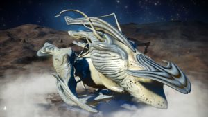 This living ship's skin is a sandy yellow with dull grey accents. It has a fin attached to its long, pointed faceplate. The faceplate also has a grey hammerhead protrusion. It's upper wings are pushed back, it's lower wings are curved and rest on the ground.